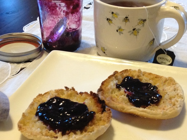 Grape Jam on buttered english muffin