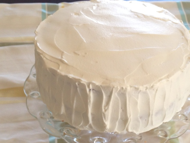 Lemon filled yellow cake with whipped cream frosting