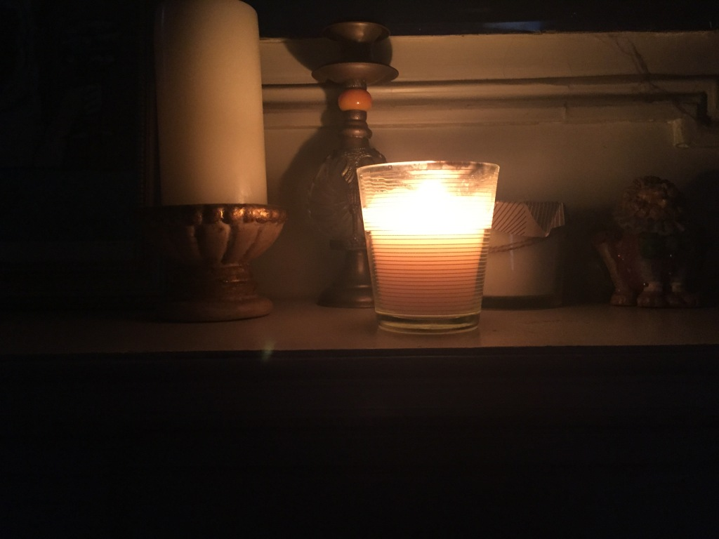 A candle burns in Brooklyn