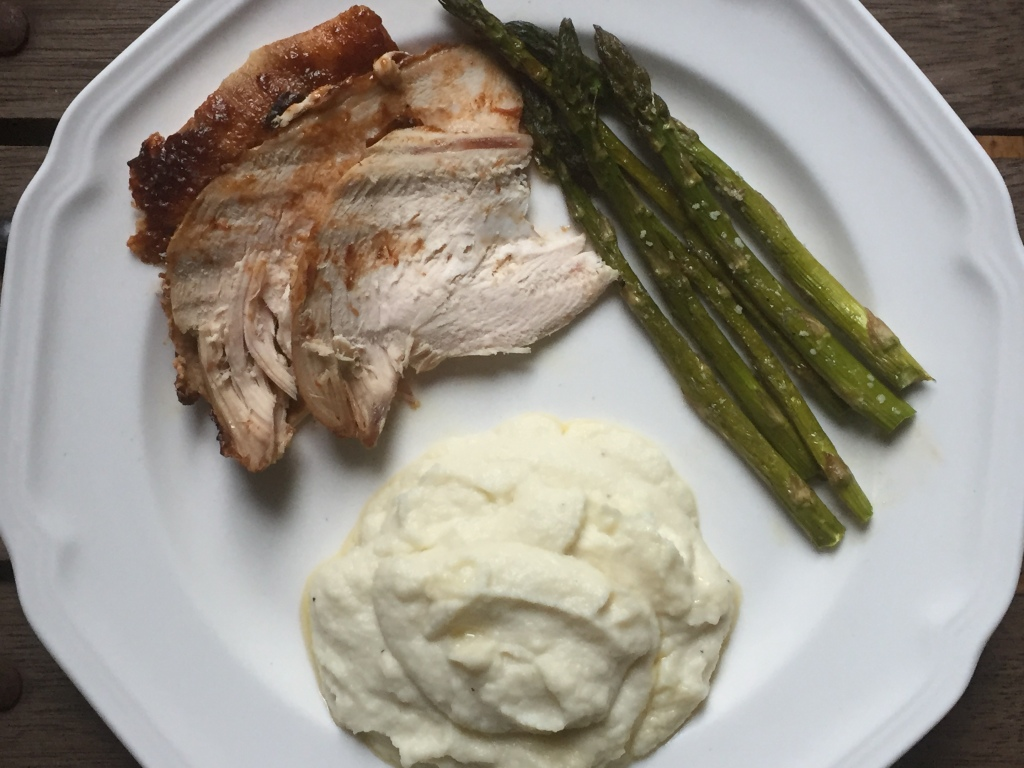 Dinner of roasted chicken, cauliflower mash and oven roasted asparagus